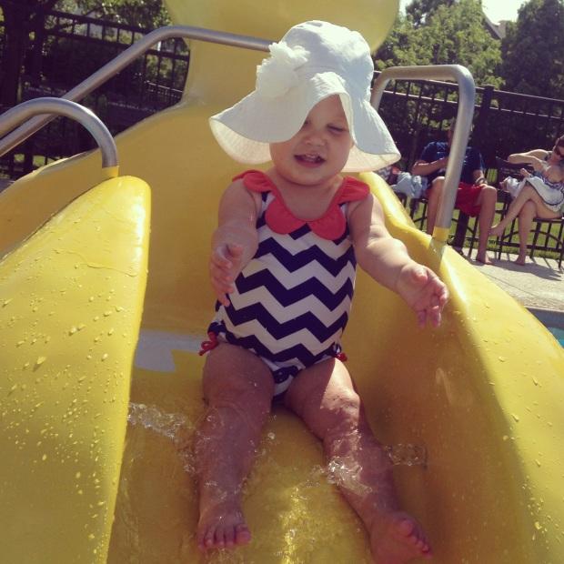 Sliding down the slide like a big girl.