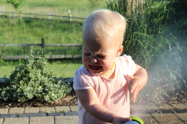 Mom of the year here.  My little is spraying herself with water and I'm grabbing the camera.  :)