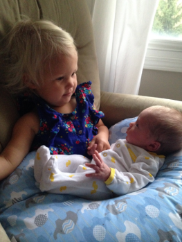 Story time by big sis before daycare.